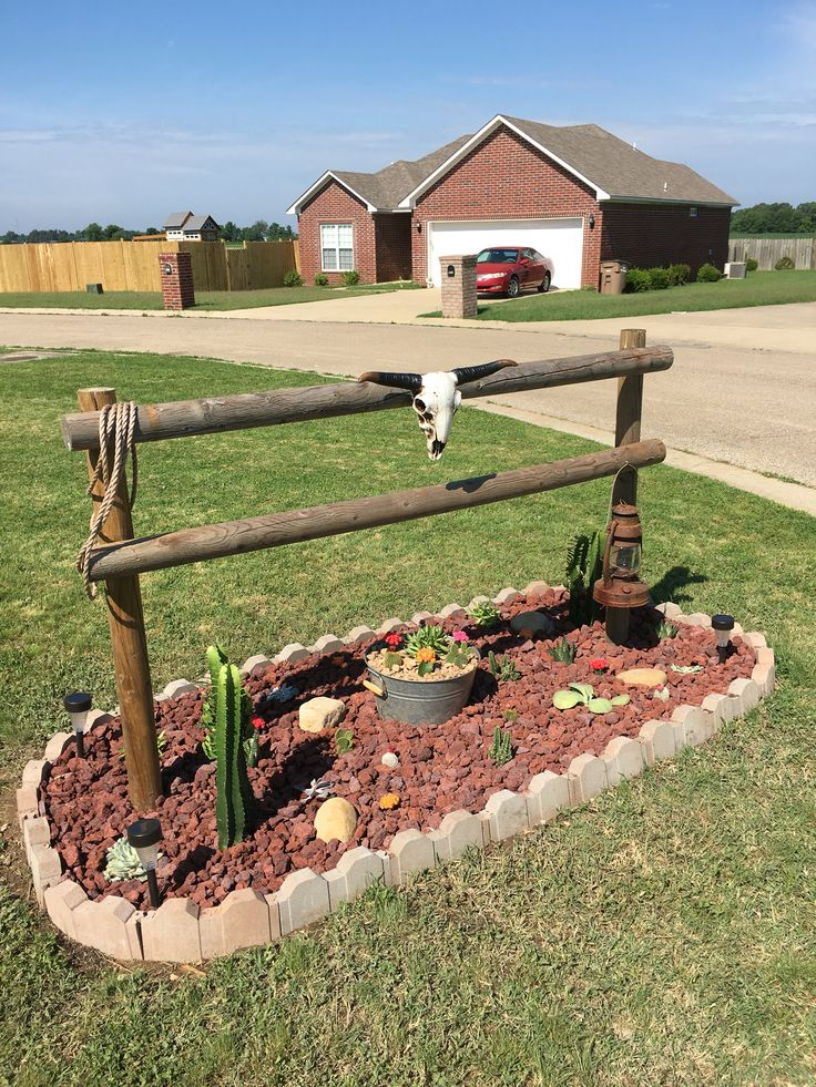 My take on the hitching post idea. I showed it with cacti which is about the only thing I can't kill, lol. The skull was an afterthought which made it better. All my neighbors love it as well.