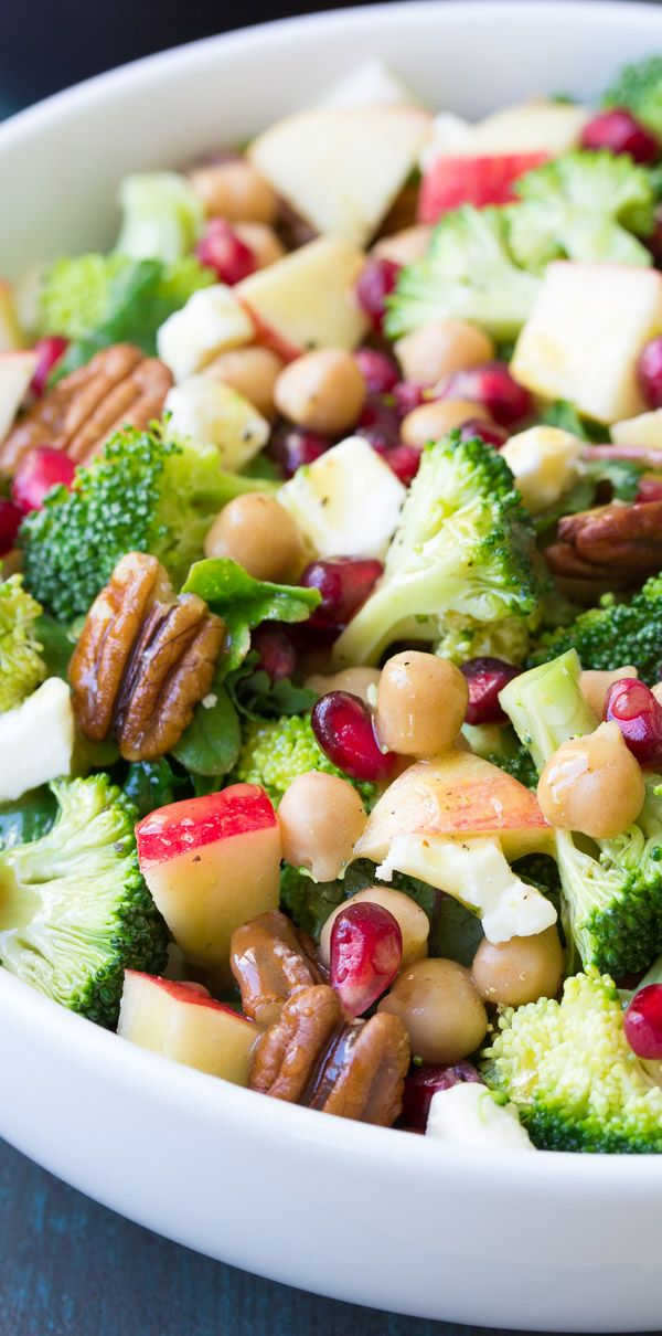 This Broccoli Kale Superfood Salad is a healthy holiday side dish. It's also delicious for lunch! With chickpeas, pomegranate seeds, apple, pecans and feta cheese. A favorite no mayo broccoli salad! #christmas #christmasrecipes #kale #broccoli #healthyfood #healthyrecipes #superfoods