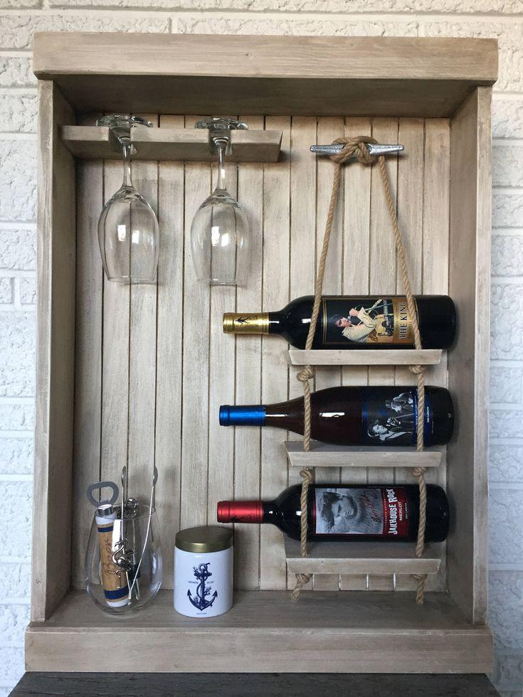 Nautical Wine Rack, Coastal Wine Storage, Wall Hanging Wine Rack, Wine Shelving, Bar Storage, Portable Bar by BeachDwellerBoutique on Etsy https://www.etsy.com/listing/515714414/nautical-wine-rack-coastal-wine-storage