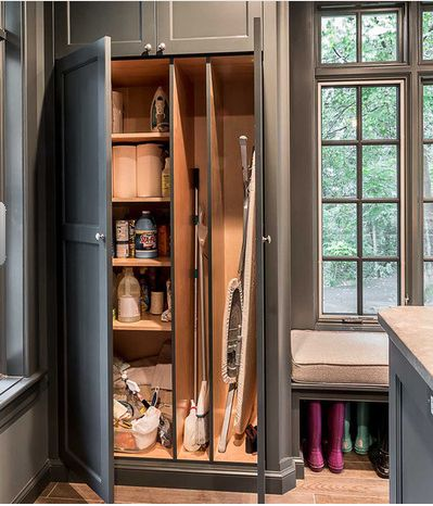 Closet for cleaning supplies mops brooms and vacuums