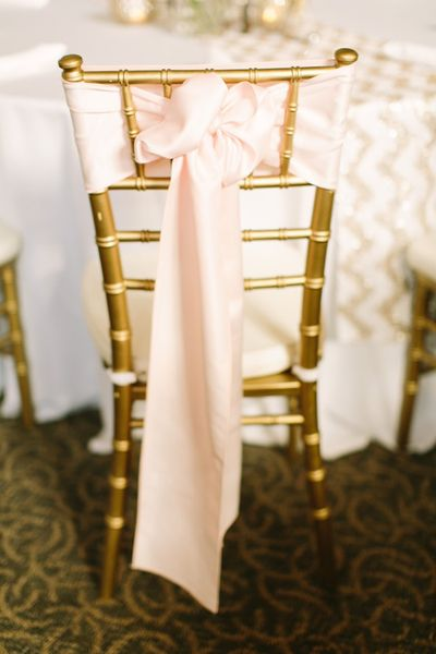 pretty pink chair bow | Mustard Seed Photography #wedding