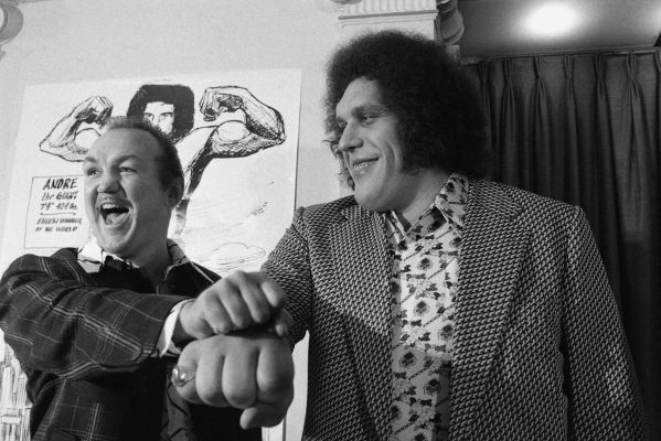 """Heavyweight boxer Chuck Wepner, left, Compares fists with Andre """"The Giant"""" Roussimoff at a New York press conference, Tuesday, May 4, 1976. It was announced that Andre had agreed to right Wepner in a mixed wrestler boxer bout. (AP Photo/Marty Lederhandler)"""