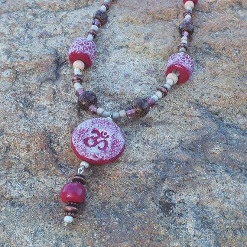 OM Peace Necklace - Plum. Om is a symbol of peace and tranquility. In Hindu beliefs OM is the first sound of creation – it is a sound, a breath, used in steady repetition in meditation to find enlightenment. OM represents the three states of the human condition – waking, dreaming and deep sleep. This sacred syllable represents Brahman the impersonal Absolute of Hinduism — the omnipotent. Hand crafted porcelain – made in Australia. Necklace Length: 63cm. $38.00au