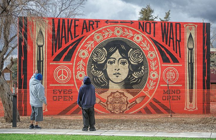 Shepard Fairey is an American street artist, designer, and activist whose work has appeared on walls and in galleries around the world. | This Street Artist Has Spent The Last 25 Years Spreading Positive Propaganda Around The World
