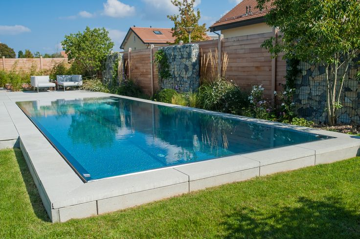 Stainless steel pool with hidden overflow trough around entire perimeter