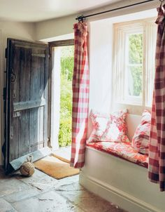 Cabbages and Roses fabrics at a cottage window seat...Full review with images galore on Modern Country Style blog: Living Life Beautifully by Christina Strutt: Book Review