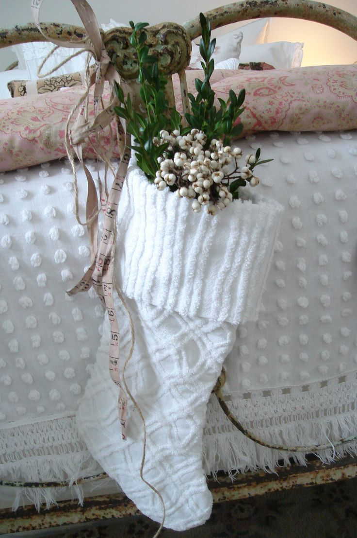 I like the stocking made out of chenille with the greenery and white berries. It would look good over Kristi's bed.