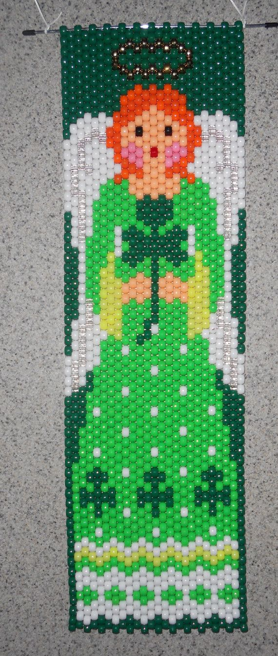 This is a St. Patricks Day Irish Angel Beaded Banner with white nylon cord for hanging. St. Patricks Day Irish Angel is holding a Shamrock, gold halo, in