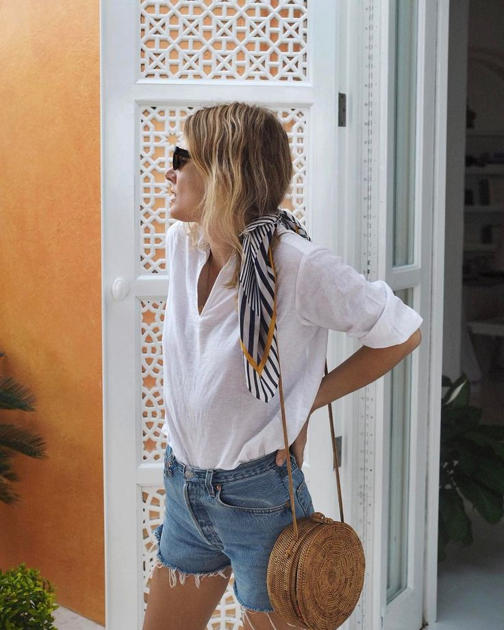 A flowy white shirt tucked into cut-off jeans. The perfect Off the Beaten Track inspired look for your next Mexico vacation. This would pair perfectly with some comfortable women's sneakers or sandals from OTBT.