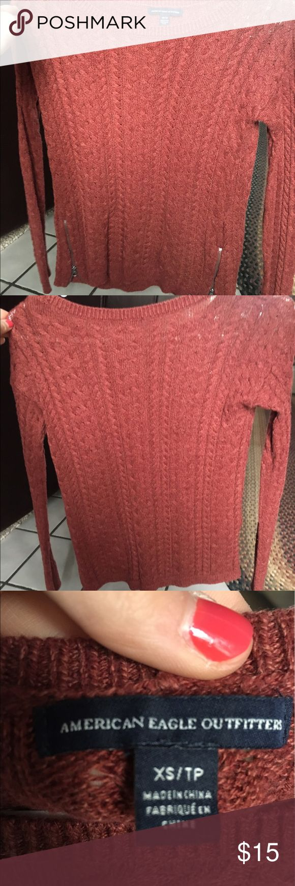 American Eagle sweater Brownish red colored American Eagle sweater. Zippers on both sides. Worn a couple times, but in great condition! Prices are negotiable! American Eagle Outfitters Tops