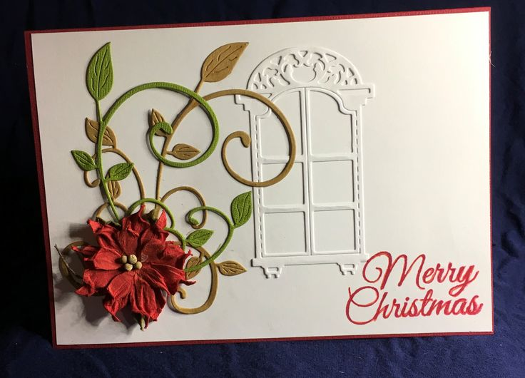 Simple white card with a die cut window and a poinsettia flower