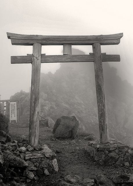 Ancient Torii at Tateyama, Japan.  A torii (鳥居, literally a bird abode) is a traditional Japanese gate most commonly found at the entrance of or within a Shinto shrine, where it symbolically marks the transition from the profane to the sacred.
