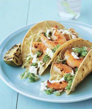 Grilled Shrimp Tacos are an easy & healthy alternative to the ordinary taco.  Serve with watermelon and you've got a scrumptious summer meal!