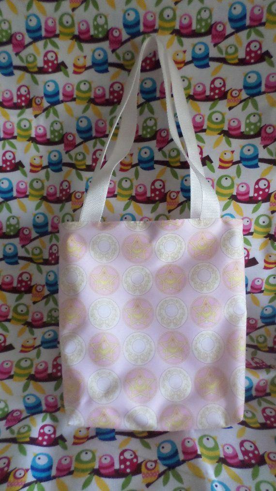 This cute mini tote bag features Sailor Moons transformation brooches and has a beautiful lining with polkadots. Its handmade by me, and can be washed