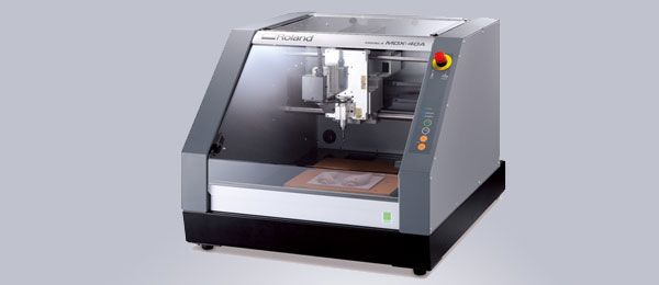 "The Roland MDX-40A CNC machine combines the advanced capabilities of a Subtractive Rapid Prototyping® (SRP) system with the ease-of-use of a benchtop CNC mill to provide product engineers and designers with a powerful 3D milling device. Unlike other CNC machines used for rapid prototyping, the compact design of the MDX-40A is the perfect fit for any office and classroom space. Max work area of 12""x12""x5"" Only $7995 and $3699 for optional rotary  axis unit from rolanddga.com"