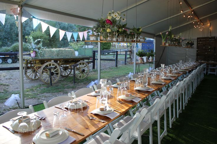 Farmyard wedding with pavilion, festoon lights, wooden trestles, Americana chairs etc. #rustic wedding #pavilion #farmyard wedding #Americana # timber trestles