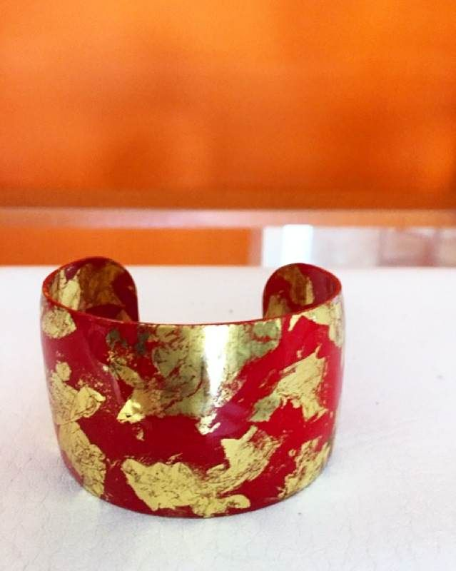 Don't you just love how festive red and gold look together? Style suggestion: This artsy bangle stands out best with dark tops! https://instagram.com/paradoxjewels/