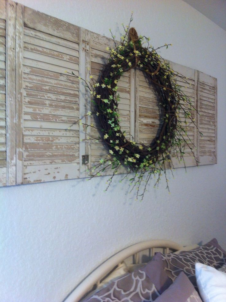 DIY wreath on shutters for above bed decor.