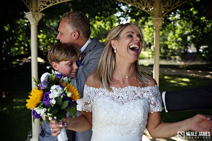 A bride heartily laughs at the end of her civil ceremony at Manor by the Lake. Documentary wedding photography via nealejames.com