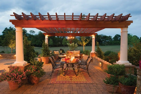 The uplighting around the poles of this pergola and along the surrounding walls lights up the entire backyard sitting area at night. Gasper Landscape Design & Construction; Photography by Rob Cardillo http://www.poolspaoutdoor.com/outdoor-products/lighting/articles/all-lit-up-landscape-lighting-techniques.aspx