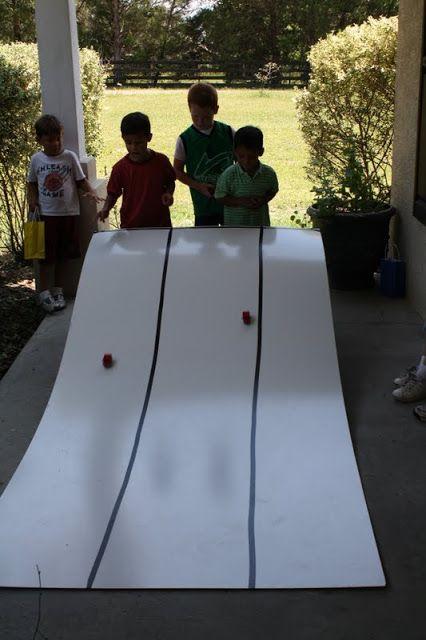 Each boy builds a lego car and races it   Farmish Momma. Could also use a raingutter & measure how far each car goes?
