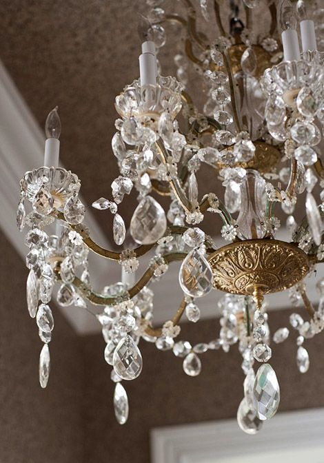 "An 1880s French crystal chandelier is an unexpected touch in a butler's pantry, ""both beautiful and surprising in such a small space."""