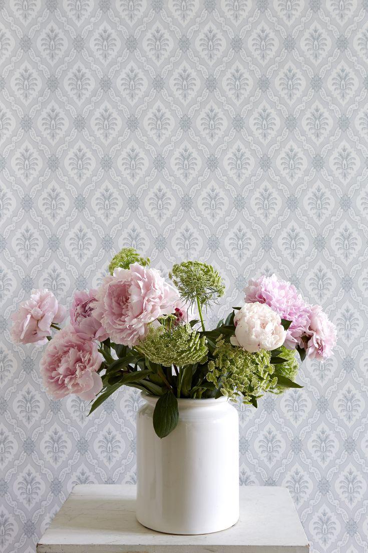 A pretty, Victorian-esque small scale floral design in a trellis formation in a…