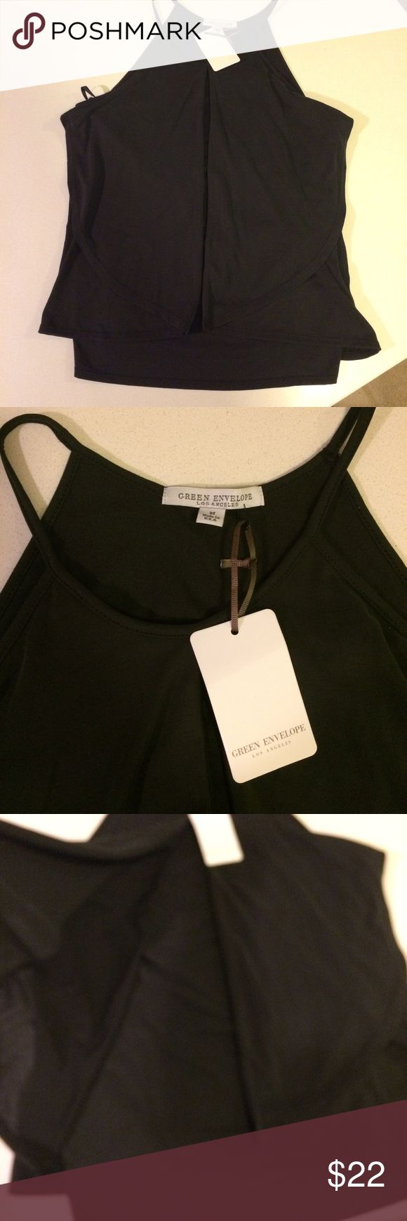Black drape front tank by Green Envelope sz Medium Ultra soft Green Envelope Los Angeles black tank. Adorable drape front that lays so nicely. Made of 65% modal, 35% polyester. Size Medium. You will not believe how soft it is! No trades but offers welcome. green envelope Tops Tank Tops