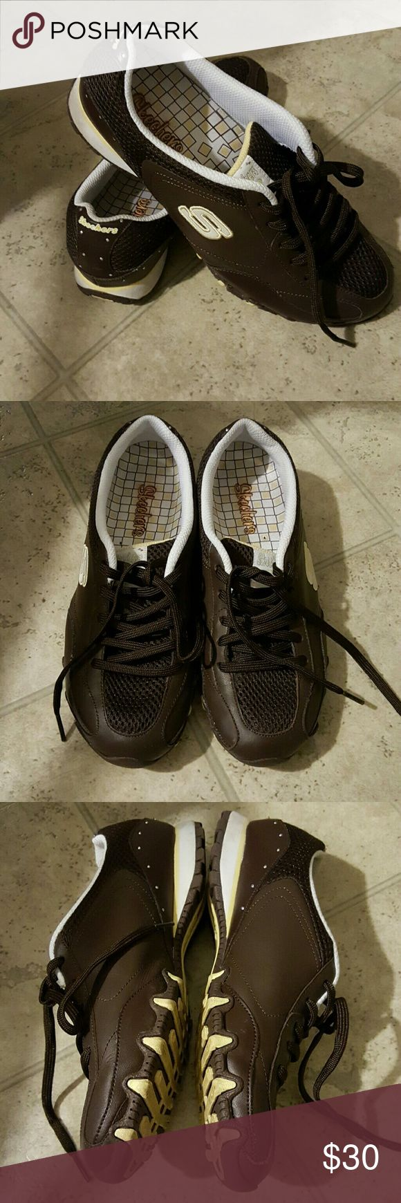 💖 Skechers Casual Chocolate Ladies Shoe's 💗 Dark chocolate lace up ladies shoe's by skechers.  Back sole is white trim with yellow and rhinestone accents. Skechers Shoes Sneakers