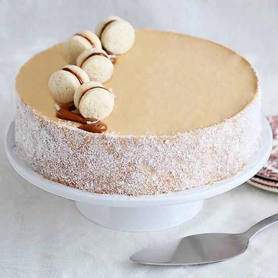 Alfajores entremet cake - coconut and dulce de leche mousse, on top of a giant alfajor cookie (in Hebrew, translator on sidebar)