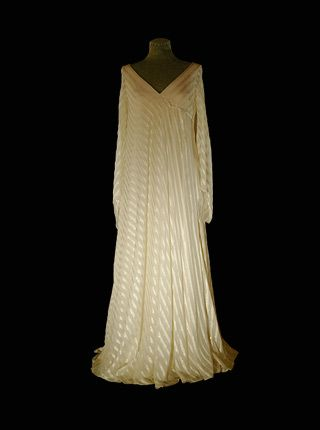 1981 - GOWN WORN BY QUEEN SILVIA OF SWEDEN TO NOBEL PRIZE CEREMONY. A CREATION OF CHAMPAGNE-COLORED CHIFFON WITH SATIN SSTRIPES BY OLGA PERSSON, STOCKHOLM.