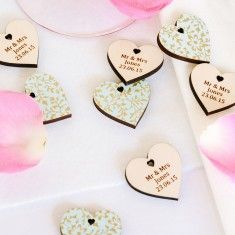 Papered Wedding Favour Hearts . These hearts are made from the best birchwood and finished with our beautiful hand made papers. We personalise each heart with  individual messages .