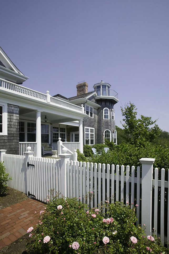 Shingle beach house with white picket fence with rose garden. Gable Building Corp.
