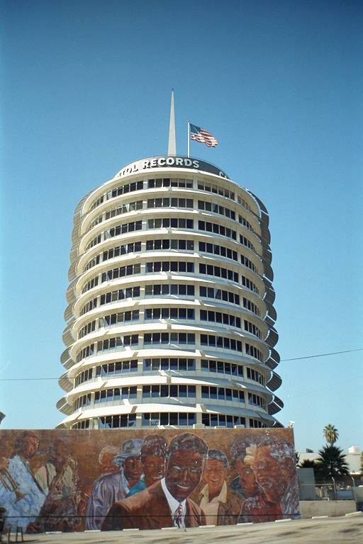 Los Angeles. Capitol Records with mural  of Nat 'King' Cole and others.