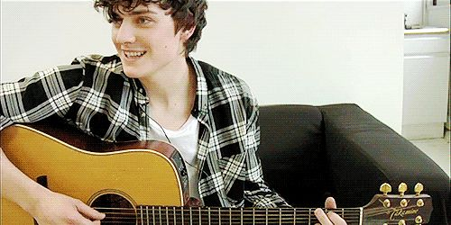 Aneurin Barnard; finger-bite gif, w/ guitar. My oh my.