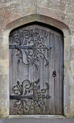 I just have this thing about scroll-work...love it.  [old wooden door w/ scroll-work hardware]