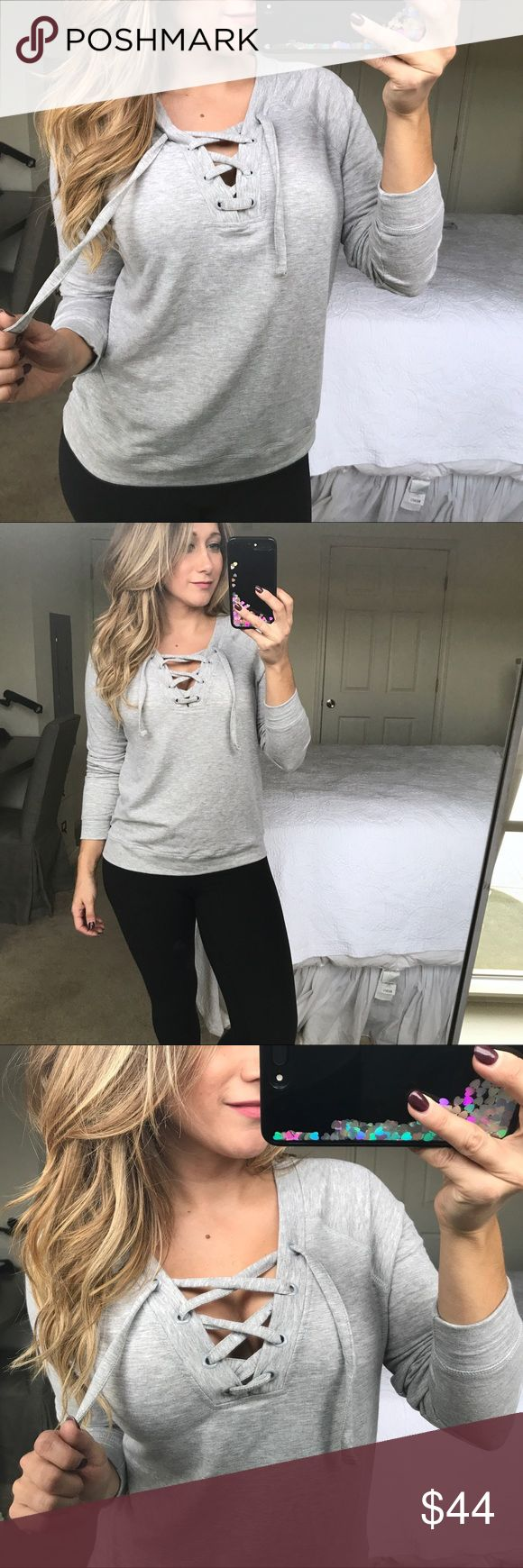 "Lace up gray sweatshirt top casual athletic wear ✨Modeling info: I'm 34D / 5'5"" / 150 lbs (Yes, I have CURVES!)   •gray lace up fitted sweatshirt (except much softer and nicer material than a traditional sweatshirt!)  •when you don't want to try to hard but still look cute!  Wear to yoga, to run errands, or with boots for a coffee date!  •modeling size M •fabric: 63% rayon 19% cotton 14% polyester 4% elastane •New with tags boutique item - price firm    ✨Please purchase directly through this…"