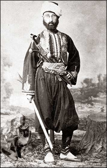 Cat of War - a bashi-bazouk - a Turkish irregular - with his little calico kitten, circa 1870. fierce and exotic, in a cute sort of way.