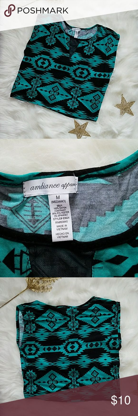 Ambiance Apparel women medium Azteca crop top This is a cute crop top that has black and green Azteca patterns on it. It has a classic neckline with short sleeves. It falls about 18 inches in length. It is in perfect condition. Ambiance Apparel Tops Crop Tops