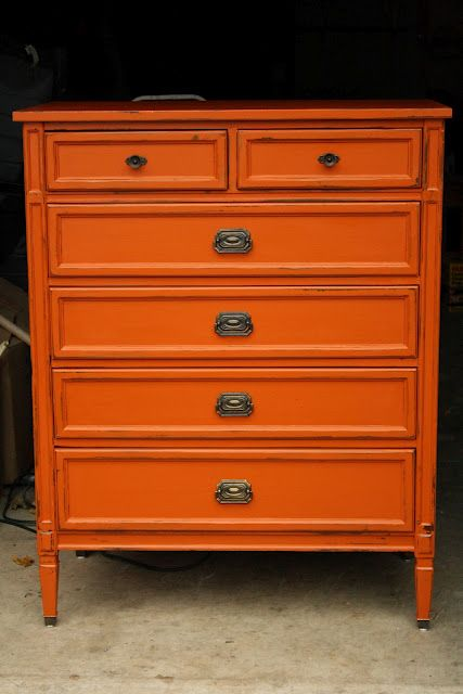 Orange painted dresser. You can get this look without primer or sanding by using Chalk Paint® decorative paint by Annie Sloan, in Barcelona Orange, then Clear Wax.
