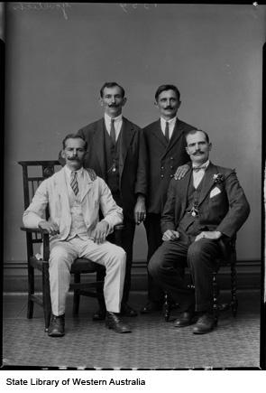 Studio portrait of the mustachioed Mr Govetich and friends, Kalgoorlie