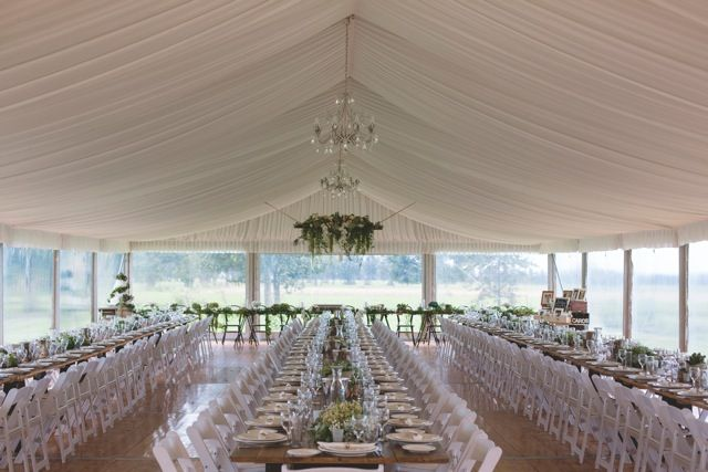 10m marquee structure, silk lining, chandeliers, vintage tables, white padded folding chairs, clear walls, integrated timber flooring, south coast weddings, south coast party hire