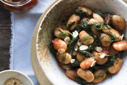 Gigante beans with sautéed spinach, almonds and olive oil