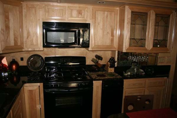 Kitchens with black appliances beautiful kitchen with for Black cabinets with black appliances