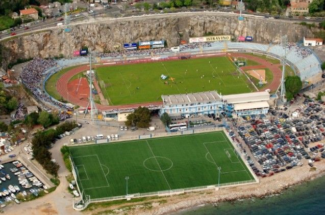 Kantrida Stadium - Croatia  Croatians certainly know how to add some scenery to a sporting event, Kantrida is sandwiched between steep cliffs and the crystal blue water of the Adriatic.  The stadium occasionally holds international matches and interestingly the Croatian national team have never been defeated while playing here.