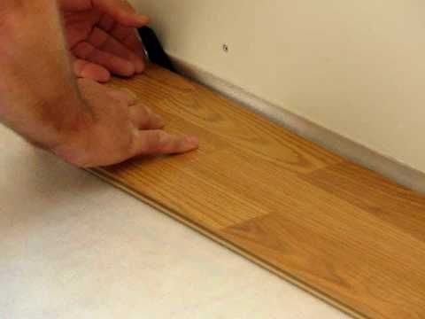 Installing Laminate Wood Flooring quick step slate tile the more difficult installation is where laminate flooring flows into Flooring 101 How To Install Laminate Flooring Tap End Joint Method Lumber