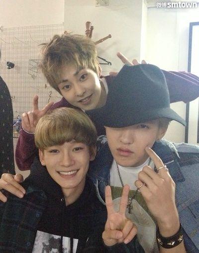 Chen, Xiumin and Kris- Kris seems very happy hahahaha :D