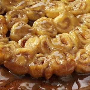 Mini Caramel Rolls Recipe from Taste of Home -- These ooey-gooey baked rolls come together in moments—thanks to a tube of refrigerated crescent roll