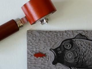 Inking up my Hungry Fish linocut with a small roller. From a tutorial on linocut printing on my Linocutboy blog. http://linocutboy.blogspot.com/
