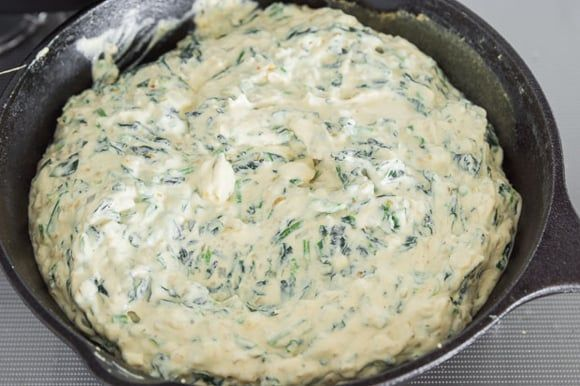 Turn down the heat and add the tofu and cashew puree. Stir constantly until the spinach dip is heated through. Adjust salt to taste.